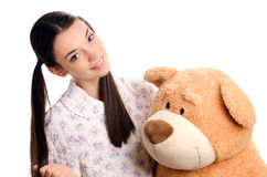 Beautiful girl with a big teddy bear. Royalty Free Stock Images