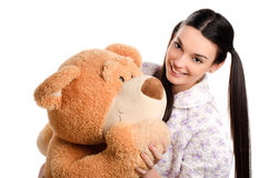 Beautiful girl with a big teddy bear. Royalty Free Stock Photography