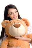 Beautiful girl with a big teddy bear. Royalty Free Stock Photo