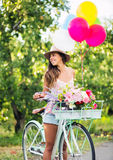 Beautiful Girl on Bike. With Balloons in Countryside, Summer Lifestyle Royalty Free Stock Images