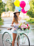 Beautiful Girl on Bike. With Balloons in Countryside, Summer Lifestyle Stock Photo