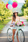 Beautiful Girl on Bike. With Balloons in Countryside, Summer Lifestyle Royalty Free Stock Photos