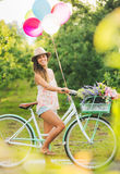 Beautiful Girl on Bike. With Balloons in Countryside, Summer Lifestyle Stock Photography
