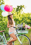 Beautiful Girl on Bike. With Balloons in Countryside, Summer Lifestyle Stock Photos
