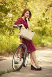 Beautiful girl with bike Stock Images