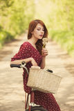 Beautiful girl with bike Stock Photo
