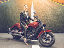 Beautiful girl-biker classic motorcycle Stock Photography