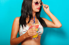 Beautiful girl in bikini with a cocktail Royalty Free Stock Image