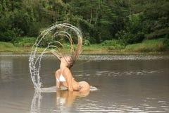Beautiful Girl in Bikini Flipping Her Hair in the Royalty Free Stock Photo