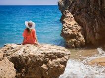Beautiful girl in a bikini, hat and tunic sunbathing Stock Image