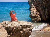 Beautiful girl in a bikini, hat and tunic sunbathing Royalty Free Stock Image