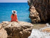 Beautiful girl in a bikini, hat and tunic sunbathing Stock Photography