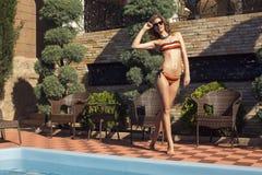 Beautiful girl in bikini relaxing on beach Royalty Free Stock Image