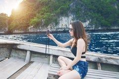Beautiful girl in bikini Selfie on the boat. Stock Photo