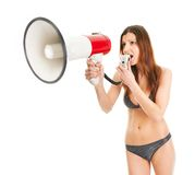 Beautiful girl in bikini shouting into megaphone Stock Images