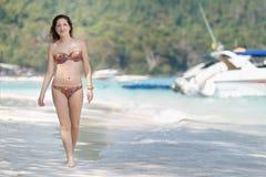 Beautiful girl in bikini walking on the beach. Beautiful girl in bikini walking on the beach Royalty Free Stock Photos