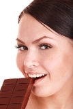 Beautiful girl bite chocolate bar. Royalty Free Stock Image