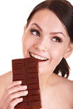 Beautiful girl bite chocolate bar. Stock Photo