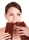 Beautiful girl bite chocolate bar. Royalty Free Stock Photography