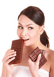 Beautiful girl bite chocolate bar. Royalty Free Stock Images