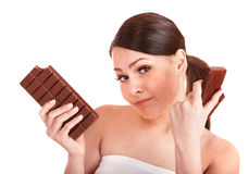 Beautiful girl bite chocolate bar. Stock Images
