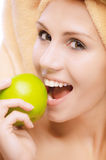 Beautiful girl bites apple Royalty Free Stock Photo