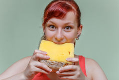 Beautiful girl bites cheese cheddar Royalty Free Stock Images