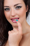 Beautiful girl is biting her finger attractively Royalty Free Stock Photography