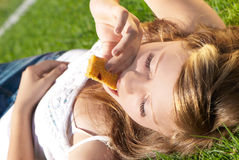 Beautiful girl is bitten by cereal bars Royalty Free Stock Photos