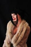 Beautiful girl on black background. Beautiful girl in fur on black background Stock Photo