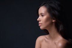 Beautiful girl on a black background Royalty Free Stock Image