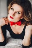 Beautiful girl in black body with red butterfly Royalty Free Stock Photography