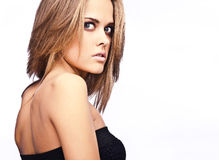 Beautiful girl in black classical dress. Royalty Free Stock Photo