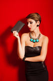 Beautiful girl with a black clutch bag in her hand Stock Photo