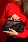 Beautiful girl with a black clutch bag Stock Image