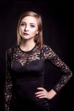 Beautiful girl in black cocktail dress Stock Photography