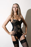 Beautiful girl in a black corset Stock Photography