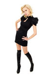 Beautiful girl in a black dress and boots should Stock Photography