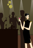 A beautiful girl in black dress with a cocktail. Group of friends at a party with a beautiful girl in black dress in front picture with a cocktail or wine Stock Image