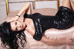 Beautiful girl in black dress Stock Photos