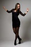 Beautiful girl in black dress dancing Stock Photo