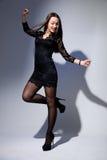 Beautiful girl in black dress dancing Royalty Free Stock Images