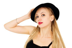Beautiful girl in a black dress with a hat. Isolated on white background stock photography