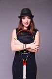 Beautiful girl in a black dress and hat with tennis racket stock photos