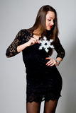 Beautiful girl in a black dress with snowflakes Royalty Free Stock Photos