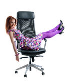 Beautiful girl on black easy chair Royalty Free Stock Images