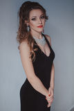 Beautiful girl in black evening dress cocktail party. 1 Royalty Free Stock Images