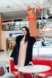 Beautiful girl in a black fur coat. Beauty Fashion Model Girl in Mink Fur Coat. Beautiful Woman in Luxury Brown Fur Jacket . Winter Fashion Stock Photo