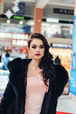 Beautiful girl in a black fur coat. Beauty Fashion Model Girl in Mink Fur Coat. Beautiful Woman in Luxury Brown Fur Jacket . Winter Fashion Royalty Free Stock Images