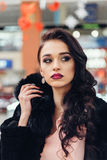 Beautiful girl in a black fur coat. Beauty Fashion Model Girl in Mink Fur Coat. Beautiful Woman in Luxury Brown Fur Jacket . Winter Fashion Royalty Free Stock Photography